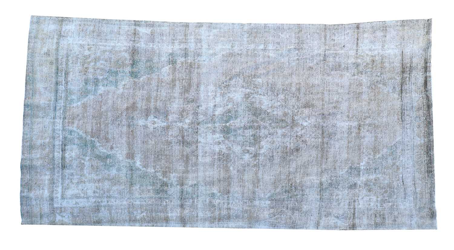A vintage Persian overdyed carpet,