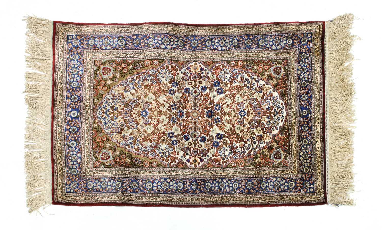 A Turkish silk and metal Hereke rug