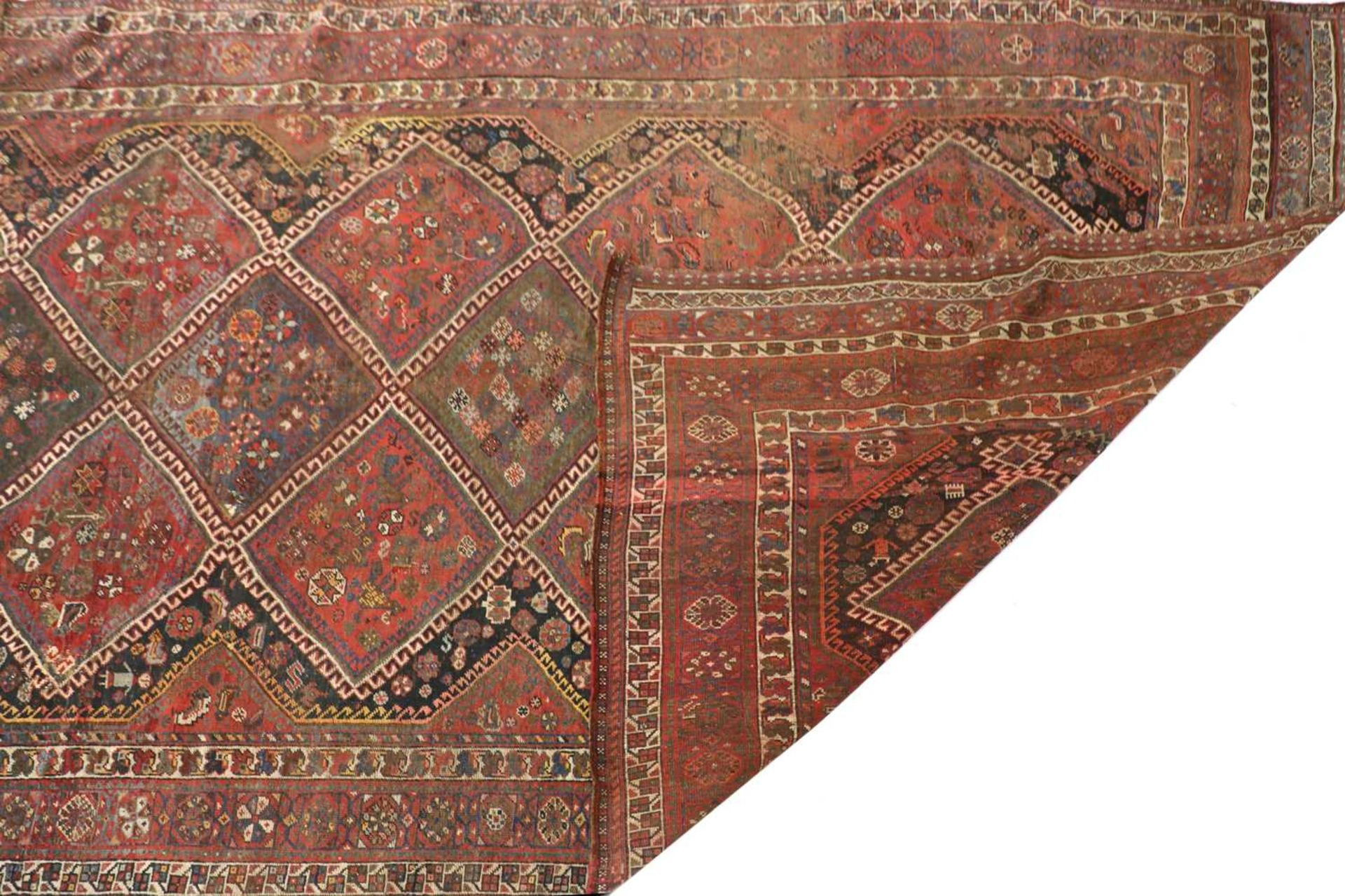 A red ground Persian carpet, - Image 2 of 2