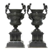 A pair of French bronze and marble garniture urns,