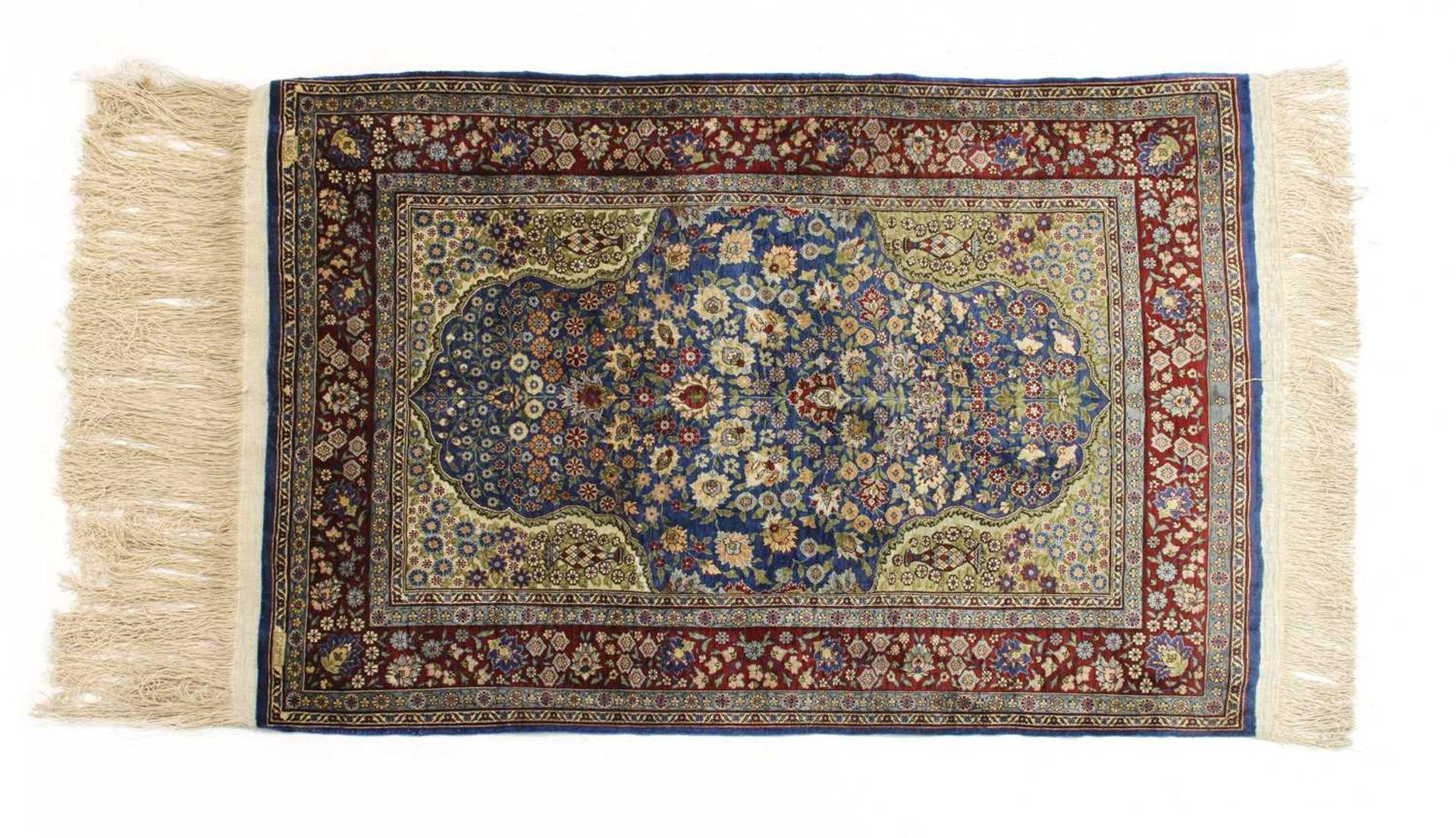 A Turkish silk and metal Hereke rug,
