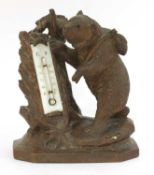 A Black Forest bear desk thermometer,