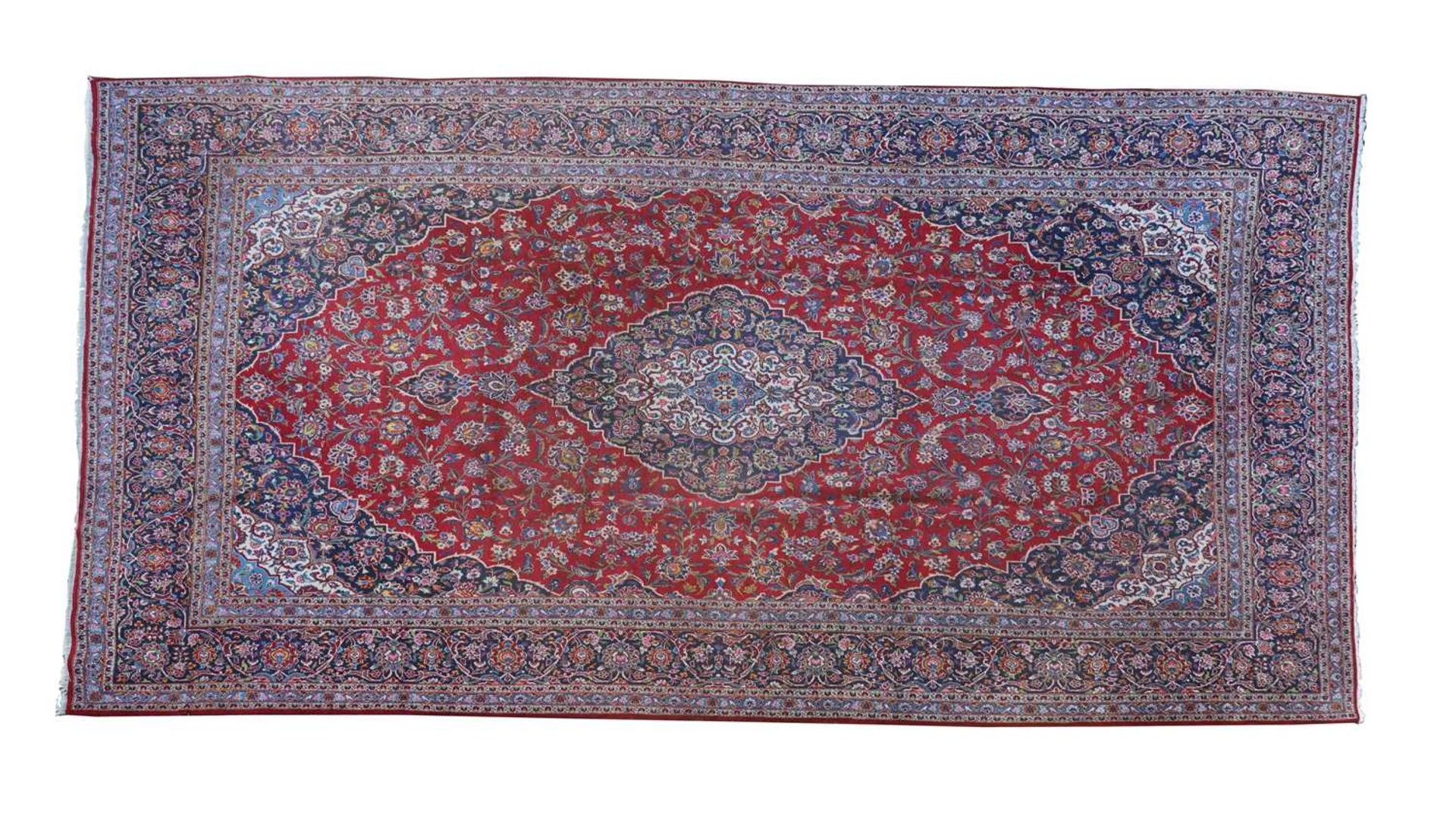 A large Persian Kashan carpet,