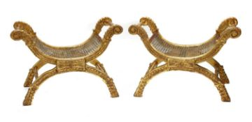 A pair of giltwood 'X' framed stools,