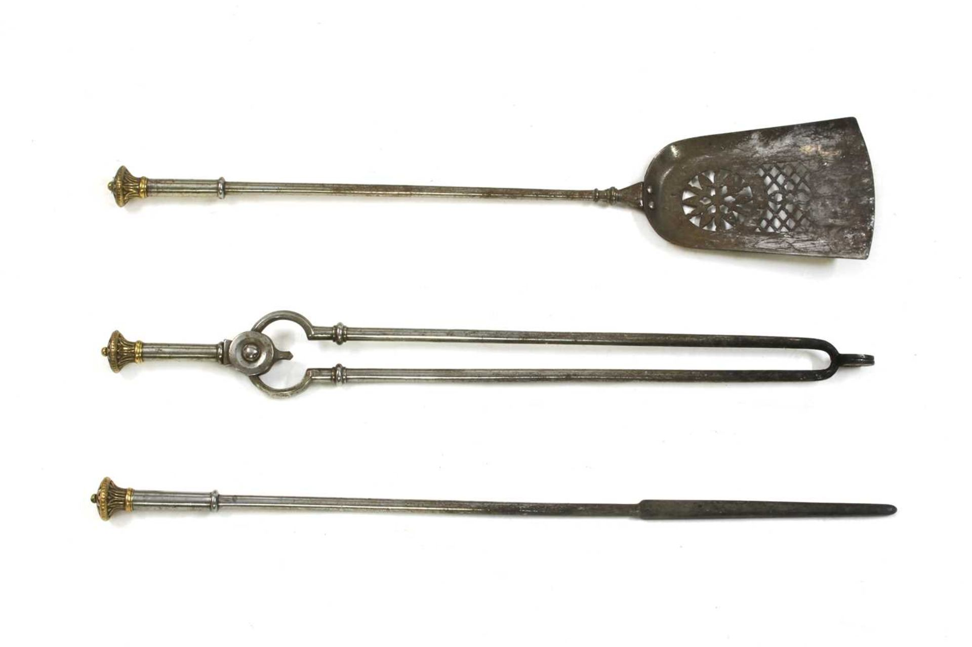 A set of George III brass and steel fire irons,