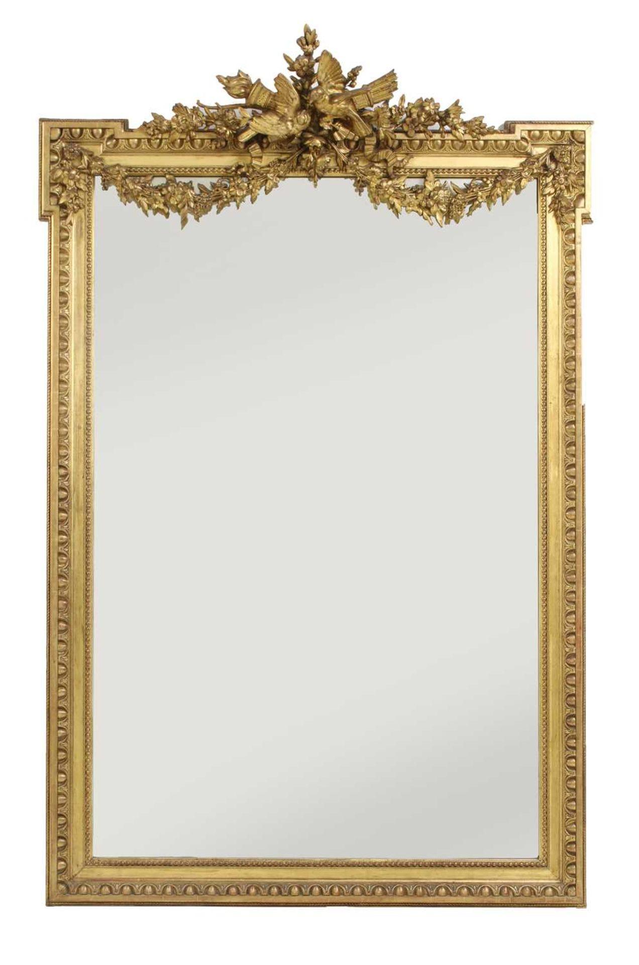 A large gilt-framed wall mirror,