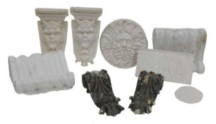 A collection of plaster corbels, brackets and plaques,