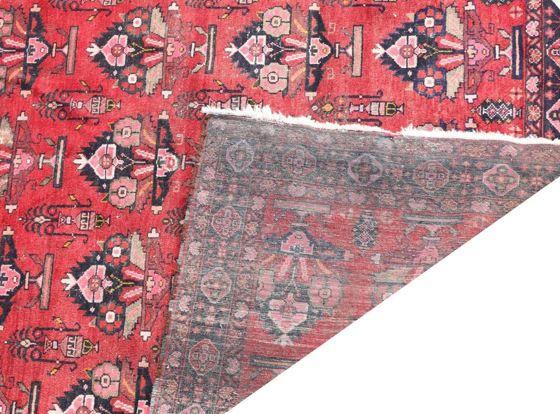 A Persian Hamadan carpet, - Image 2 of 2