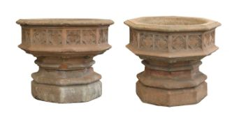 A pair of Indian sandstone octagonal planters,