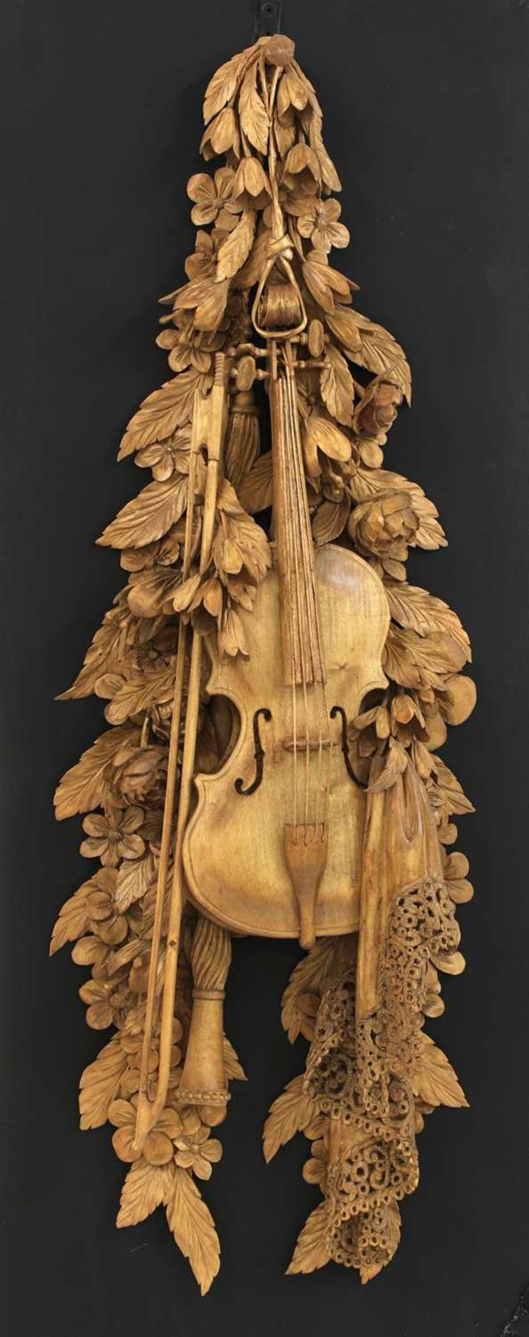 A carved wall hanging in the style of Grinling Gibbons,