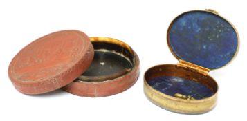 A circular papier-mâché box and cover