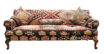 A three-seater settee,