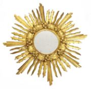 A Spanish giltwood sunburst mirror,