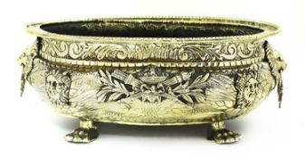 An embossed brass wine cooler,