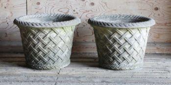 A pair of Haddonstone garden urns,