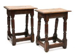 A pair of oak joint stools,