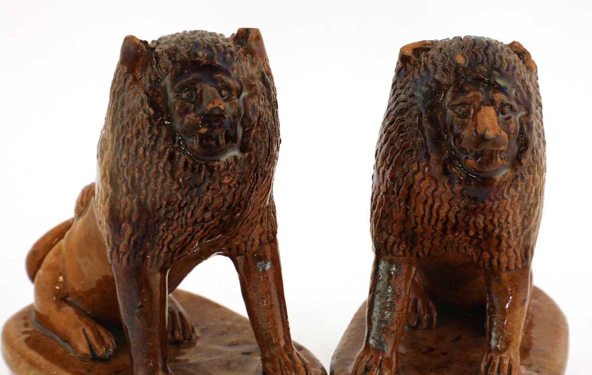 A pair of treacle-glazed pottery lions, - Image 4 of 4