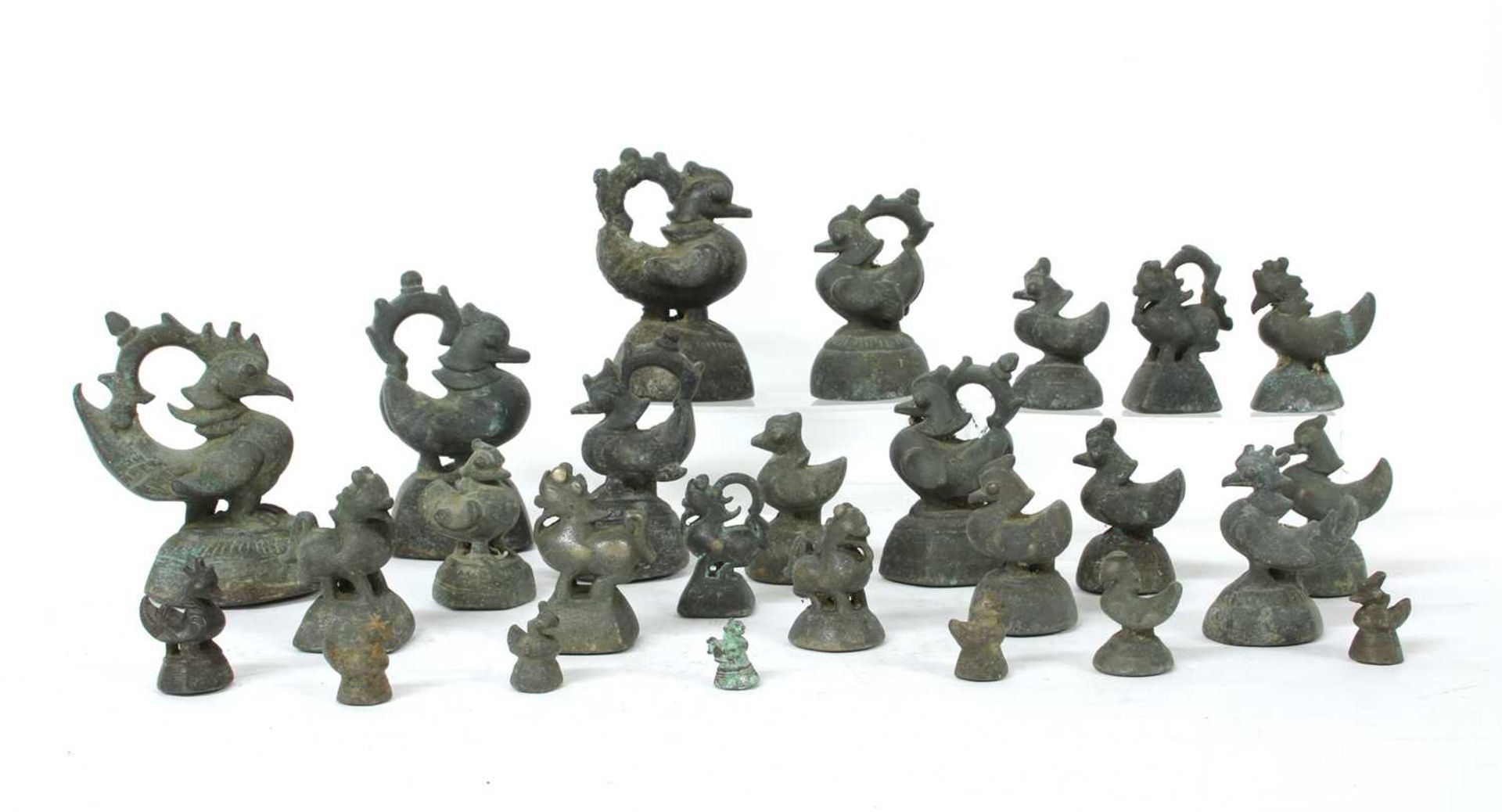 A collection of Burmese bronze opium weights,