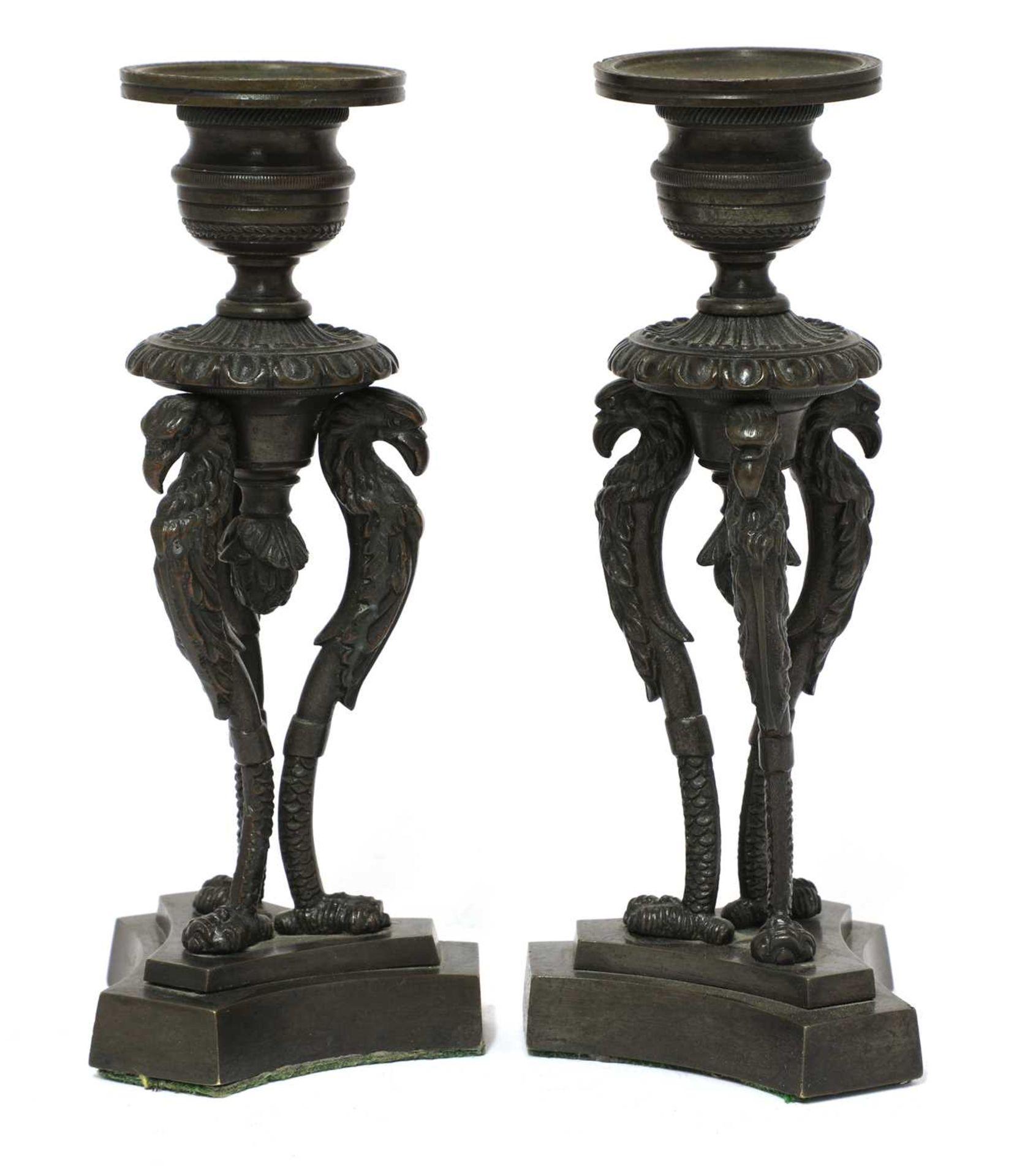 A pair of bronze candlesticks,