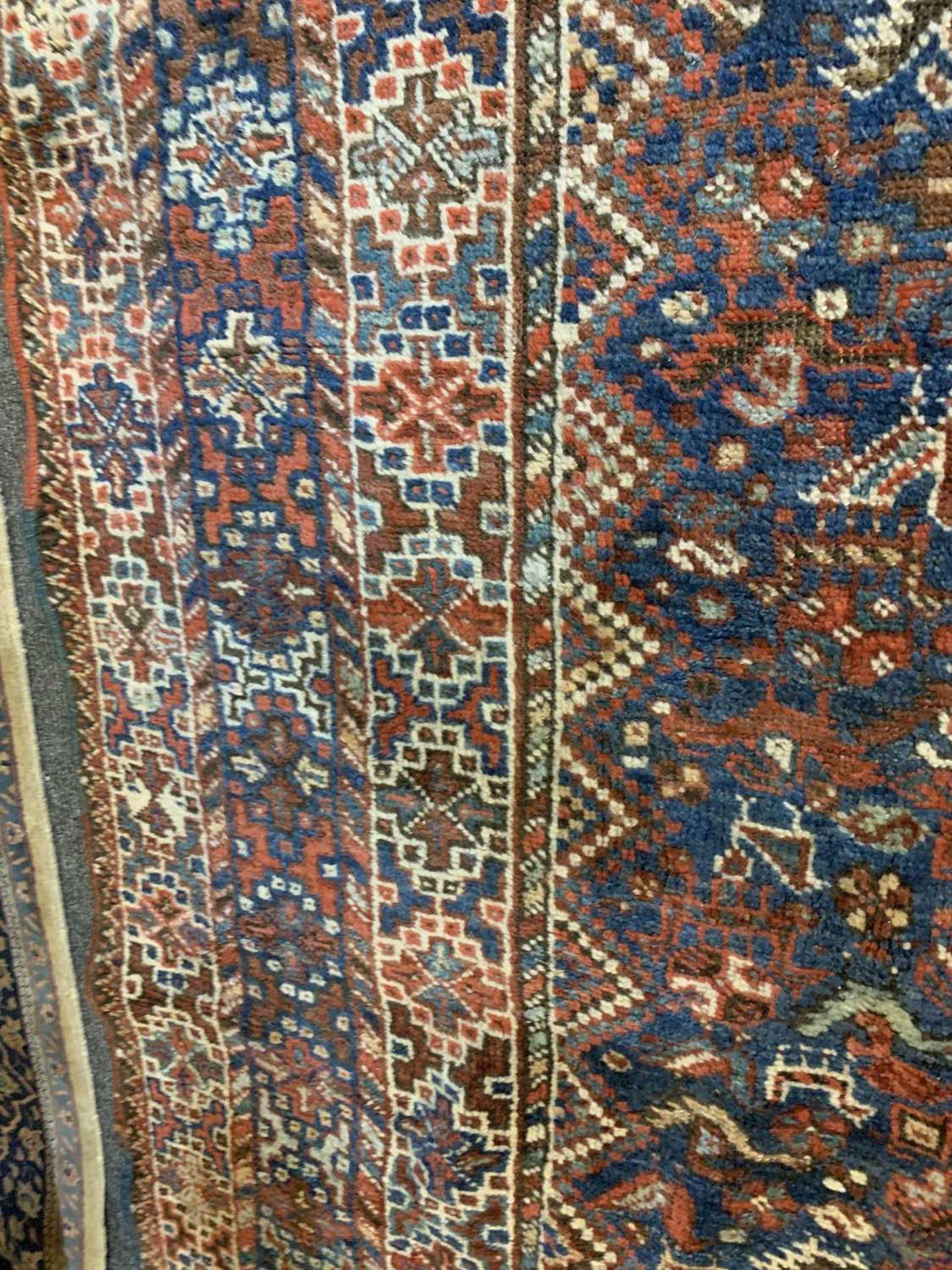 A Persian Khamseh carpet, - Image 13 of 15