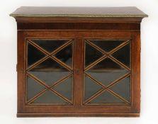 A George III strung mahogany cabinet,