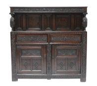 A carved oak buffet cupboard,