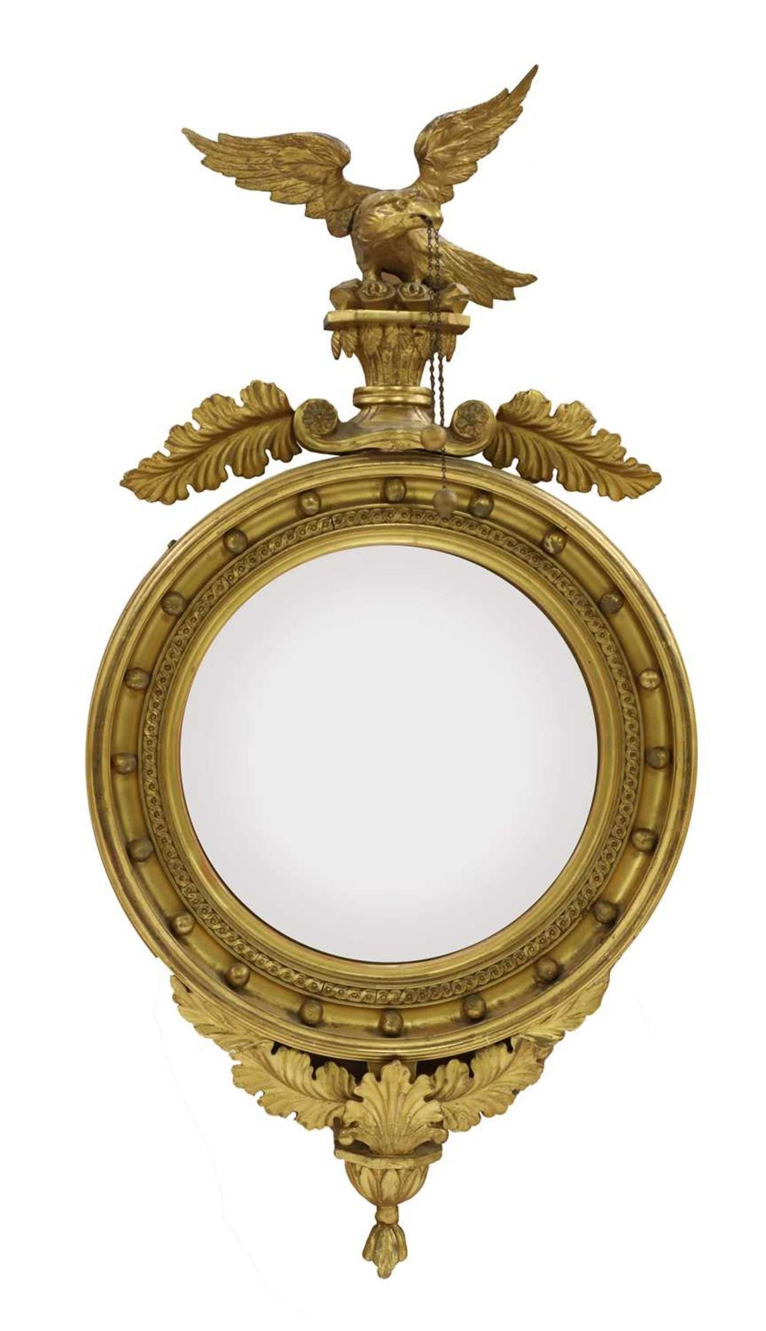 A Regency-style carved giltwood convex wall mirror,