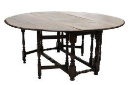 A large oak gateleg table,