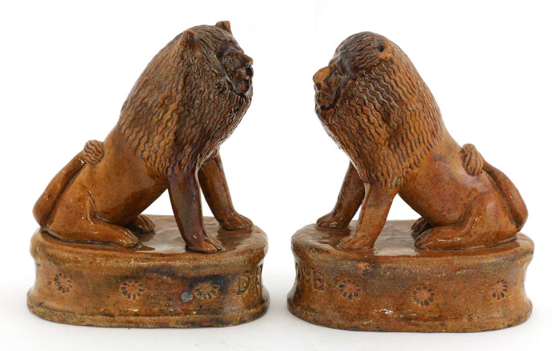 A pair of treacle-glazed pottery lions, - Image 2 of 4