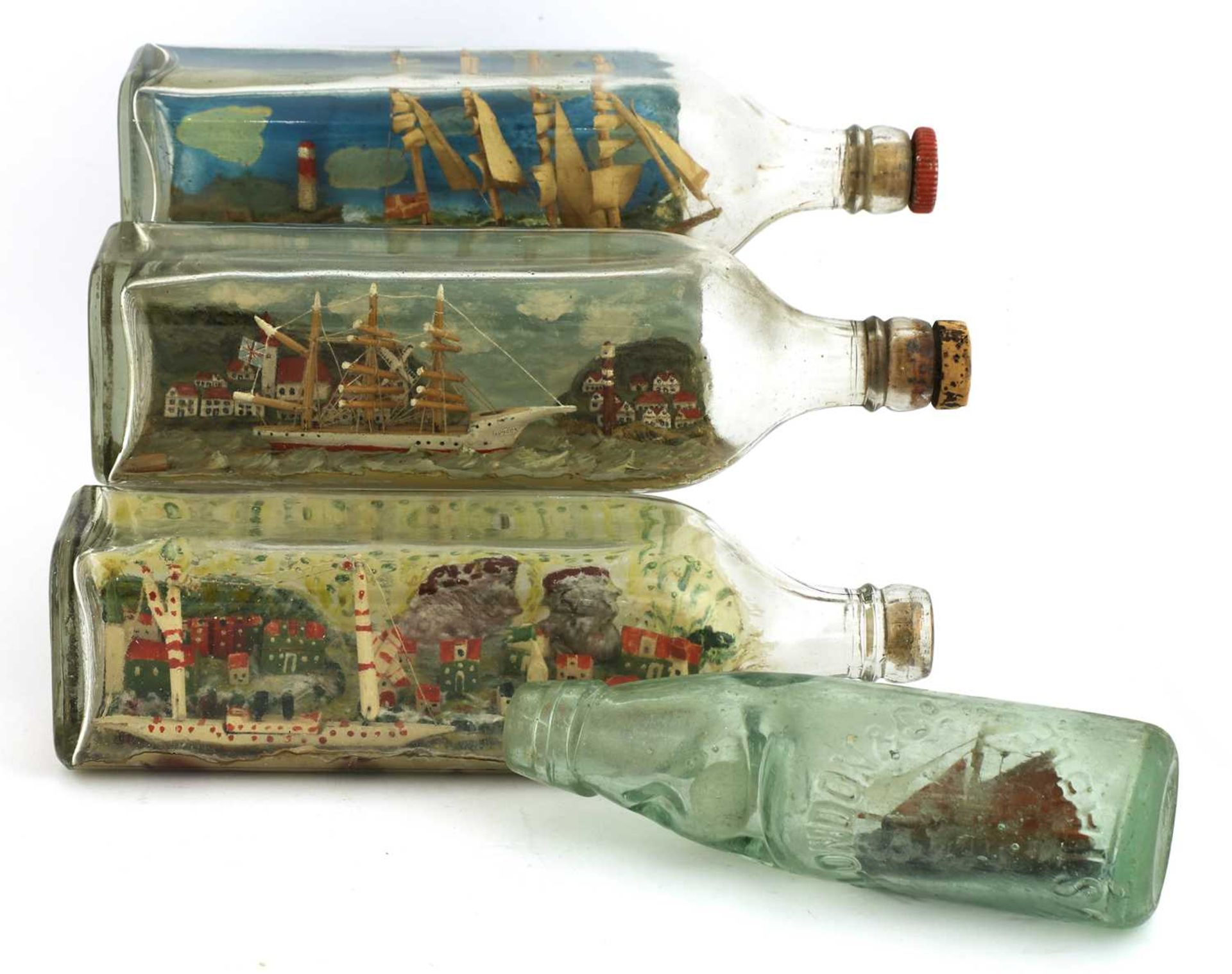 Four ships in bottles