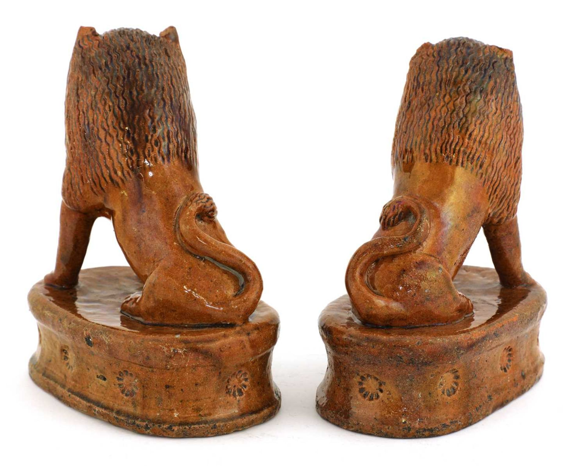 A pair of treacle-glazed pottery lions, - Image 3 of 4