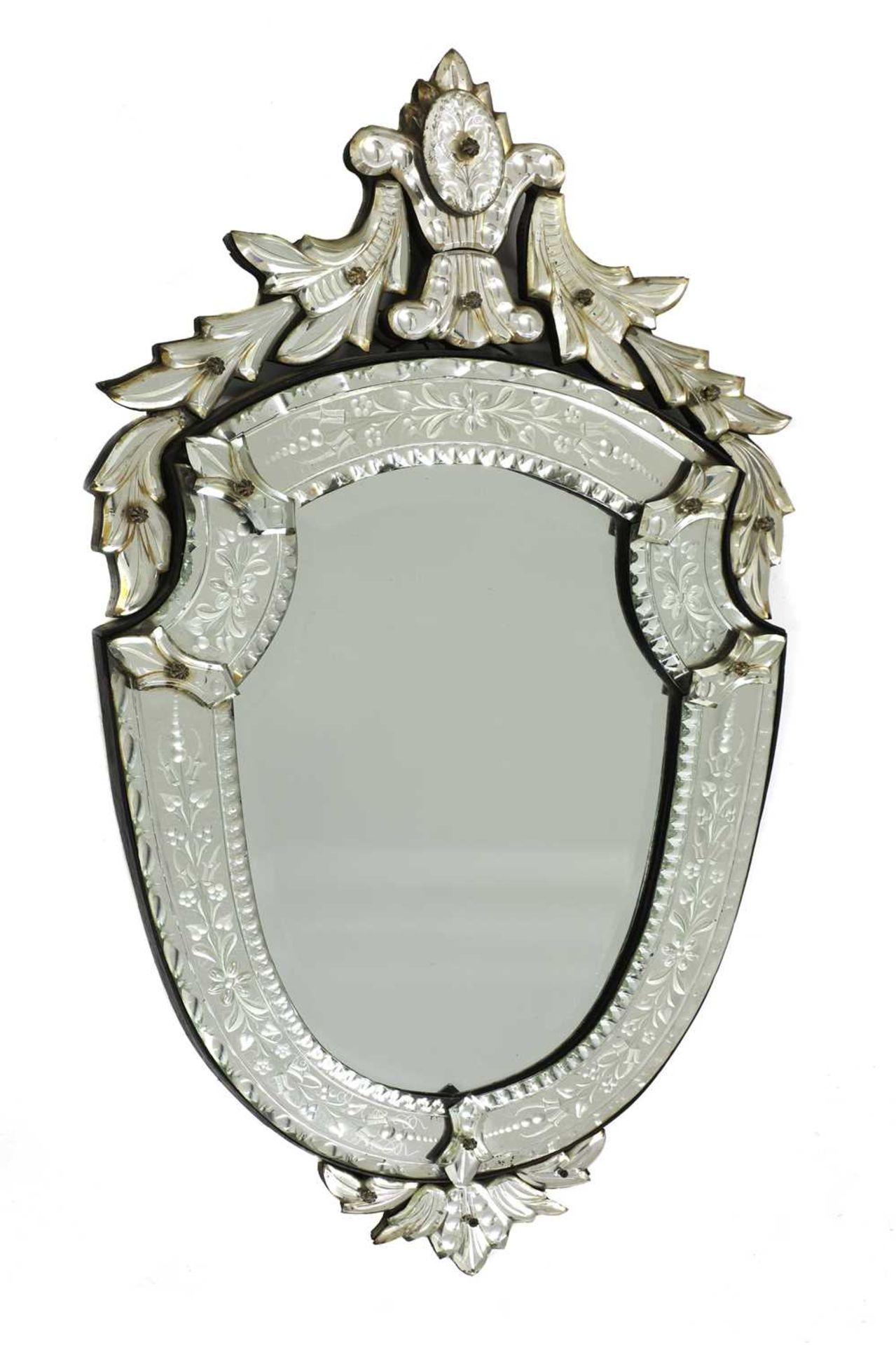 A Venetian wall mirror,