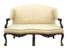 A Continental carved settee,