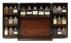 A mahogany cased travelling apothecary cabinet,