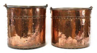 A pair of copper fireside buckets,
