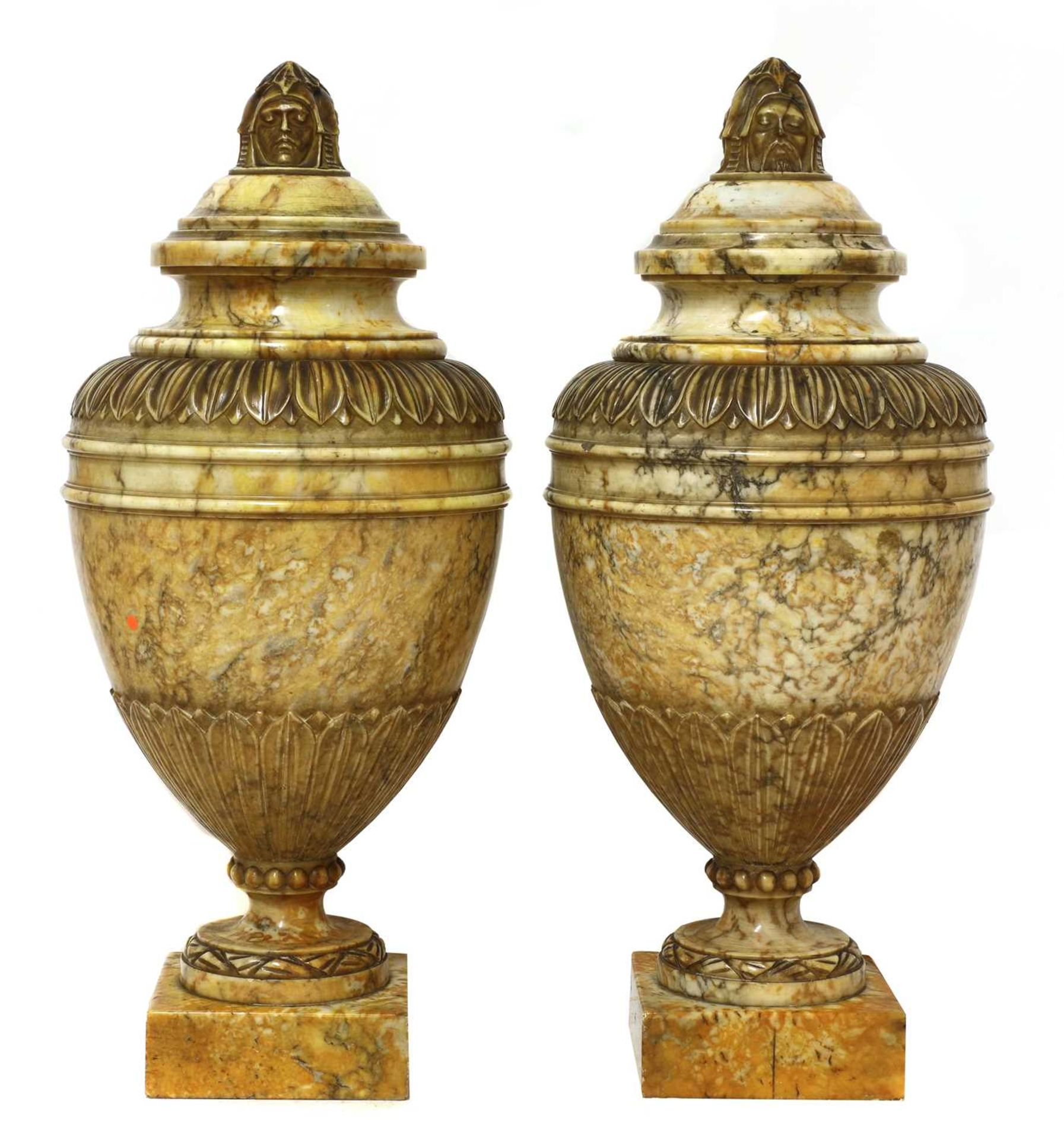 A pair of alabaster urns and covers