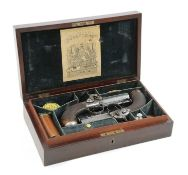 A cased pair of percussion travelling pistols by Forsyth & Co,