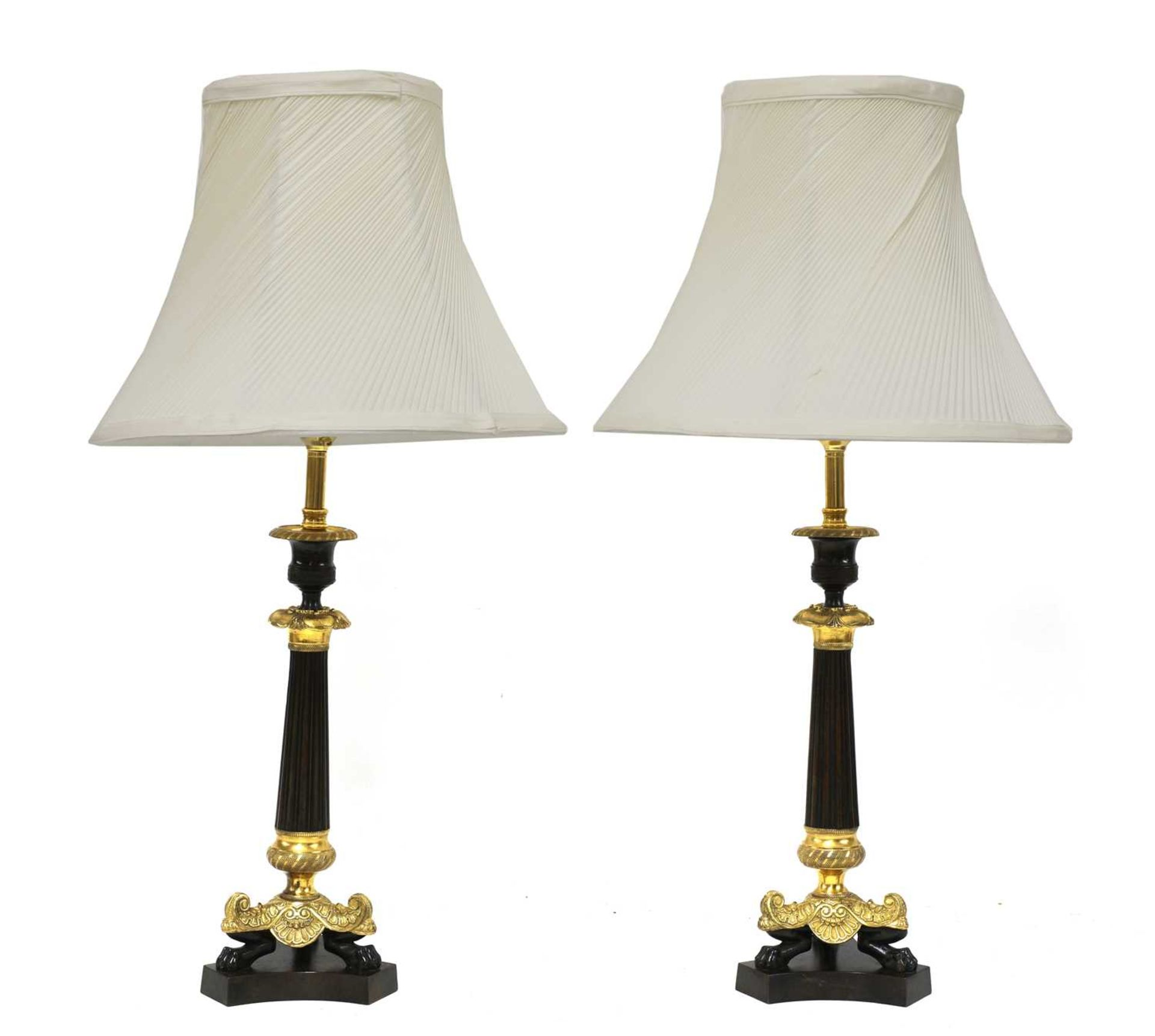 A pair of French Empire-style bronze and gilt-bronze candlesticks,