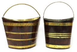 Two similar mahogany and brass bound peat buckets,