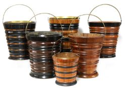 A collection of five Dutch turned wooden peat buckets,