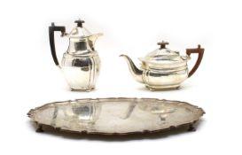 A composed silver three-piece tea service