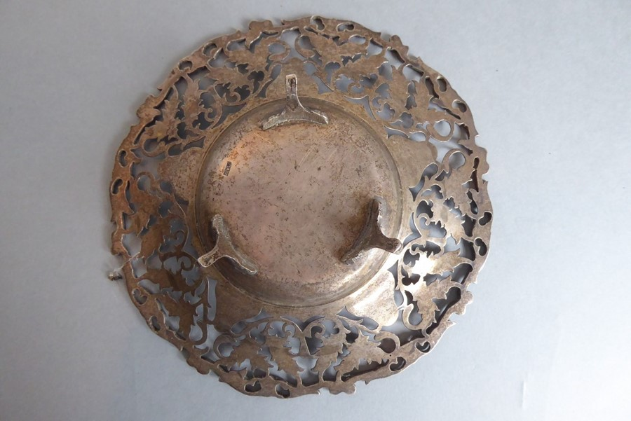 Lot 102 - A late 19th century / early 20th century continental pierced white-metal dish based on three legs (