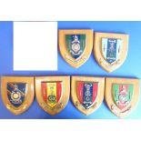 Six shield-shaped wall mounted Royal Marine Regimental plaques including 43 Commando, 45 Commando,