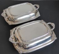 A pair of early 20th century fine silver-plated two-handled entrée dishes with the handle