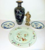 Two 18th century blue-and-white Chinese saucers, together with an 18th century Chinese famille