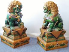 A large and very imposing pair of floor-standing ceramic karashishi (Buddhistic temple lions),