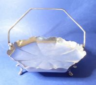 A heavy early 20th century hallmarked silver octagonal cake basket on four cast feet marked for