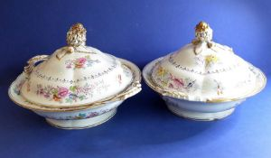 A pair of late 19th century circular two-handled tureens and covers, gilded and decorated with