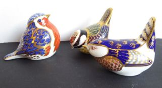 Three Royal Crown Derby paperweights modelled as small birds to include a blue tit and a wren