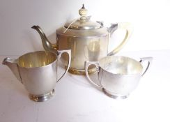 A heavy Art Deco period hallmarked silver three-piece tea service, the teapot with ivory handle